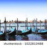 gondolas in venice  italy.... | Shutterstock . vector #1022813488