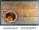 plate with dried fruits on a... | Shutterstock . vector #1022828593