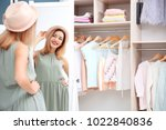 young woman looking into mirror ... | Shutterstock . vector #1022840836