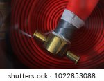 fire extinguisher and fire hose ... | Shutterstock . vector #1022853088