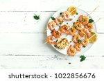 grilled shrimp skewers. seafood ... | Shutterstock . vector #1022856676