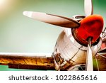 Stock photo old airplane turboprop engine with propeller blades parts of wings and aircraft fuselage concept 1022865616