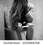 a depressed woman with a... | Shutterstock . vector #1022866768
