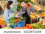 smiling male shopping assistant ... | Shutterstock . vector #1022871658