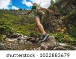 hiking sporty girl runs along... | Shutterstock . vector #1022883679