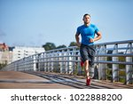 handsome athletic man out... | Shutterstock . vector #1022888200