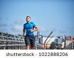 athletic man jogging  running  ...   Shutterstock . vector #1022888206
