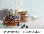 chocolate pancakes with syrup... | Shutterstock . vector #1022900320