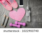 gym stuff  phone and heart on... | Shutterstock . vector #1022903740