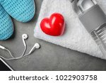 gym stuff and red heart on grey ... | Shutterstock . vector #1022903758