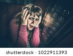 shocked woman with... | Shutterstock . vector #1022911393