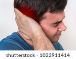 Small photo of Man with earache is holding his aching ear - body pain concept