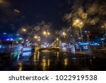rainy night and traffic in the... | Shutterstock . vector #1022919538