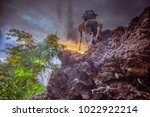 adventure man hiking with... | Shutterstock . vector #1022922214