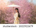 beautiful young woman wearing... | Shutterstock . vector #1022922679
