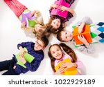 the cute children with books  | Shutterstock . vector #1022929189