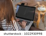 young woman use balnk screen... | Shutterstock . vector #1022930998