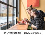 two freelance working in coffee ... | Shutterstock . vector #1022934088