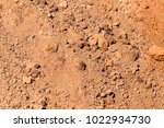 red clay soil on nature as a... | Shutterstock . vector #1022934730