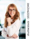 a beautiful mature... | Shutterstock . vector #1022941540