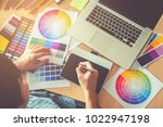 graphic designer drawing on...   Shutterstock . vector #1022947198