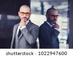handsome man in a gray business ... | Shutterstock . vector #1022947600