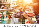 group of happy friends eating... | Shutterstock . vector #1022948434