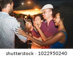 group of happy friends drinking ... | Shutterstock . vector #1022950240