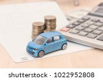 car with calculator and money... | Shutterstock . vector #1022952808