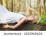 blond woman in white dress... | Shutterstock . vector #1022965624