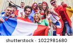 group of happy sport supporters ... | Shutterstock . vector #1022981680