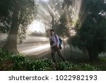 photographer hipster man in the ... | Shutterstock . vector #1022982193