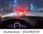 blurry car silhouette seen... | Shutterstock . vector #1022983729