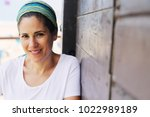 portrait of beautiful 40 years... | Shutterstock . vector #1022989189