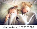 portrait mother and daughter... | Shutterstock . vector #1022989600