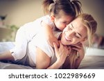 plying with my baby girl is... | Shutterstock . vector #1022989669