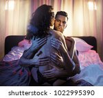 loving couple posing in bedroom.... | Shutterstock . vector #1022995390