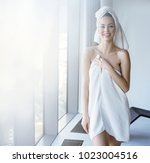 brunette beauty wearing white... | Shutterstock . vector #1023004516