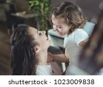 happy mother with a daughter at ... | Shutterstock . vector #1023009838