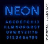 blue neon tube alphabet font.... | Shutterstock .eps vector #1023014644