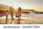 happy family enjoying sunset in ... | Shutterstock . vector #1023017290