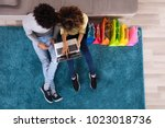 young couple shopping online on ... | Shutterstock . vector #1023018736