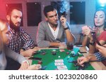 young people play poker at the... | Shutterstock . vector #1023020860
