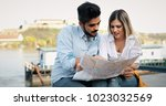 smiling couple in love... | Shutterstock . vector #1023032569