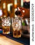 close up of expert bartender... | Shutterstock . vector #1023032929