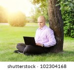 Man With Laptop Sitting Near A...
