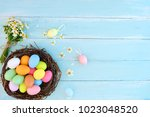 colorful easter eggs in nest ... | Shutterstock . vector #1023048520