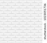 ceramic white brick tile wall.... | Shutterstock .eps vector #1023051736
