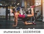 side view of attractive...   Shutterstock . vector #1023054538