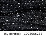 water drops on black background | Shutterstock . vector #1023066286